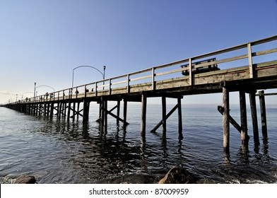 wooden pier reaching out to the sea
