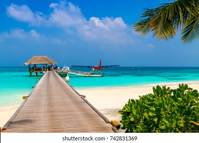 Wooden pier with a seaplane in a tropical island