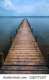 Wooden pier at silence lake, fall colors