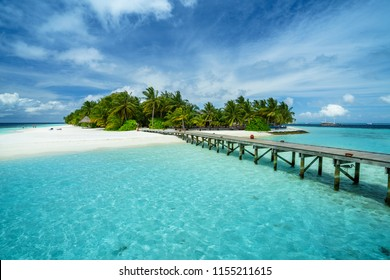 Wooden pier at tropical island resort. Maldives