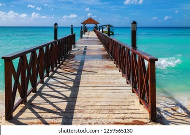 Wooden pier with turquoise sea background on caribbean island