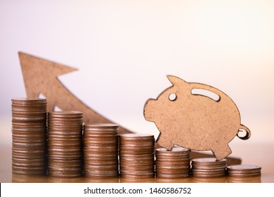 Wooden pig and stack of coins. Pension fund, 401K, Passive income, Investment and retirement concept. savings and making money, Business investment growth concept. Risk management.