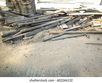 Wooden pile beside construction site
