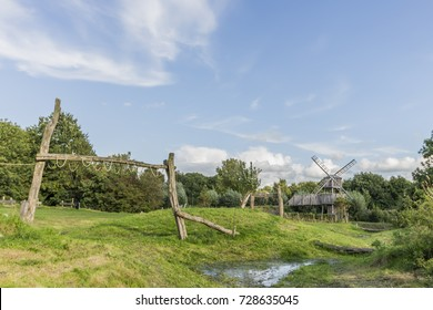 Wooden pillars playground with a wooden windmill tower in the background in a forest park in Alkmaar, the Netherlands