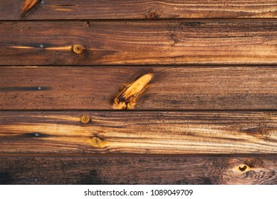 Wooden pine background, stained with age