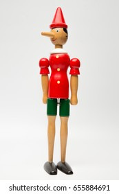 Wooden Pinocchio doll isolated on white background