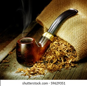 Wooden Pipe and Tobacco design.Over Black background