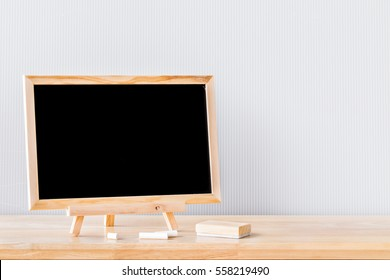 Wooden plank table for graphic stand product, interior design or montage display your product with blank texture blackboard with chalk for background. education concept.