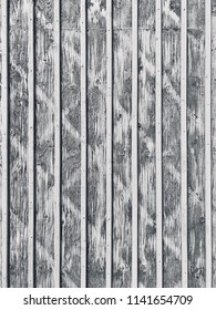 Wooden plank wall in grey tones with texture as background.