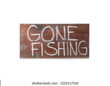 "Wooden plank with words ""GONE FISHING"" on white background"