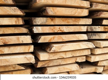 Wooden planks. Air-drying timber stack. Wood air drying (seasoning lumber or wood seasoning). Timber. Lumber. Close-up.