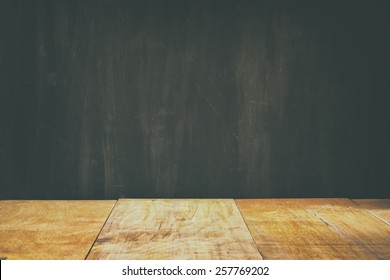 wooden planks and black board background. ready for mock up or product placement