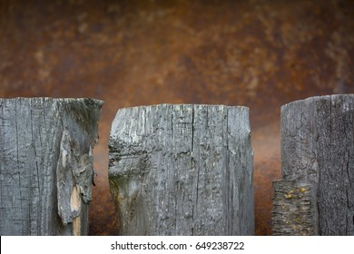 the wooden planks of the fence on a brown background rusty metal