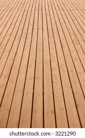 Wooden planks floor fading away to the horizon