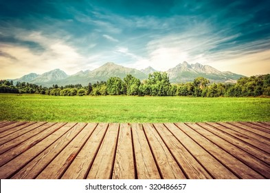 Wooden planks floor with summer mountain landscape. Beautiful view on High Tatra Mountains, Slovakia.