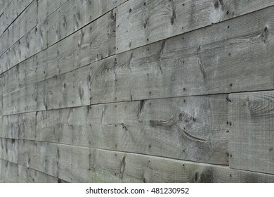 Wooden planks gray background viewed at an angle