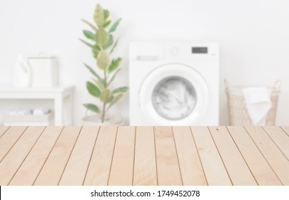 Wooden planks table template in laundry room for product display