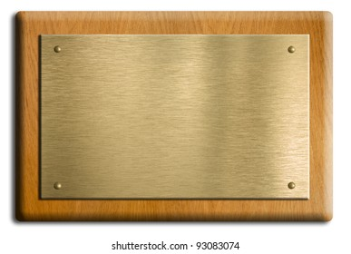 Wooden plaque with gold or brass plate isolated on white. Clipping path is included.