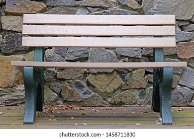 A Wooden and Plastic Park Bench At A Local Nature Center
