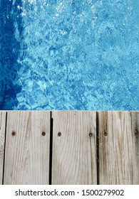 wooden platform on swimming pool background. top view. Procurement, a template for design with place for text. Old boards and a lake copy space.