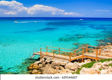 Wooden platform with steps to azure sea water near Protaras, Cyprus island