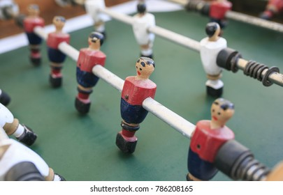 Wooden players in a foosball table