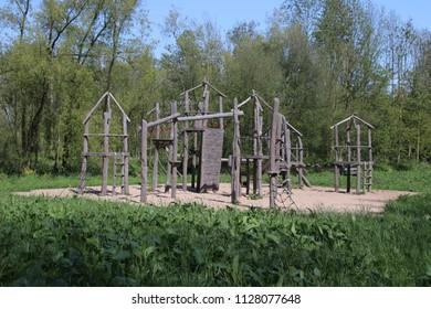 wooden playing tools on playground in park Hitland in Nieuwerkerk aan den IJssel.