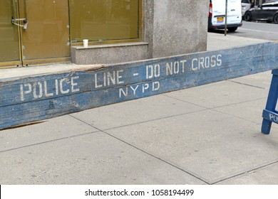 Wooden police barrier with stenciled lettering