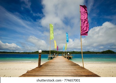 A wooden pontoon with beautiful colourful flags on one of the island of the mentawai in west sumatra, Indonesia