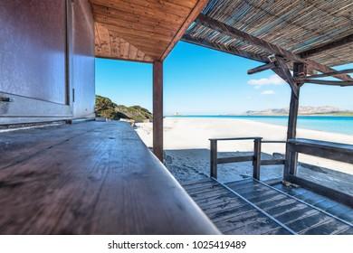 wooden porch in La Pelosa beach, Sardinia