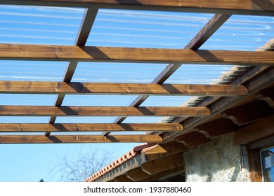 wooden porch with transparent roof