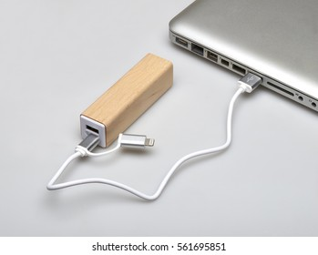 Wooden portable external power bank, for emergency phone recharge isolated on white with clipping path