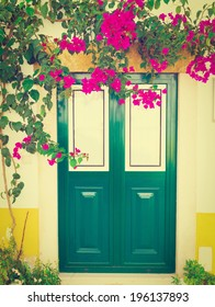 Wooden Portuguese Door Decorated with Red Bougainvillaea, Retro Effect