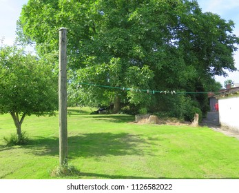 Wooden post and cloth line on farmhouse lawn in Southern Denmark