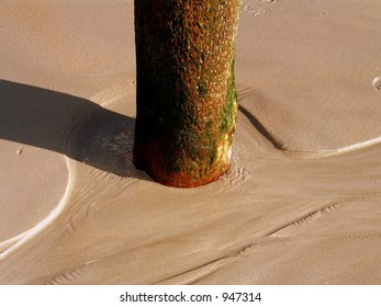 Wooden Post in Sand