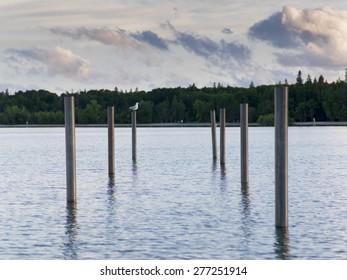 Wooden posts in the lake, Lake Winnipeg, Riverton, Hecla Grindstone Provincial Park, Manitoba, Canada