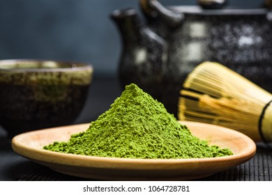 Wooden pot with green matcha tea powder.