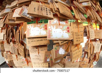 Wooden prayer wish boards signifying the year of the rabbit at a Japanese shrine. At New Years time, shrine boards are full of these wooden prayers.