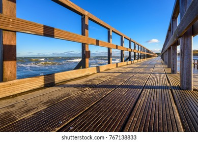 Wooden promenade along the Baltic sea in Darlowko. Northern Poland.