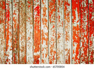 Wooden protection on all background, with traces of a red paint