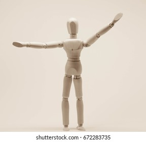 Wooden puppet freedom and happy concept isolate on retro style background.