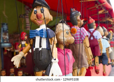 wooden puppet group in a market stall