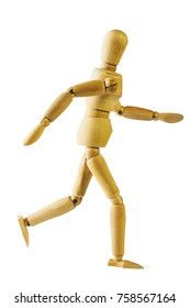 Wooden puppet walk action in white isolated with clipping path