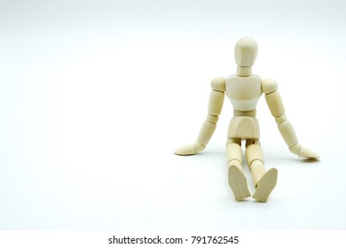 Wooden puppet.Wooden figure posed as if leaning on something. Room for text or objects to be inserted.