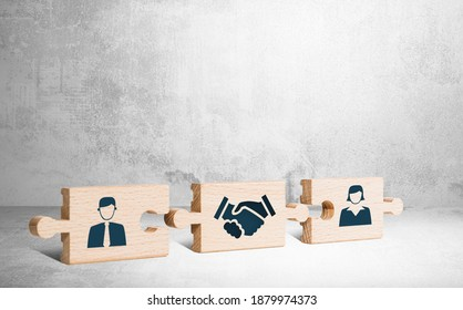 Wooden puzzle with icons of a man, mediator and woman. The concept of the role of a mediator in saving the family, mediation.