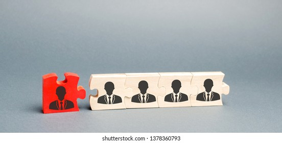 Wooden puzzles with the image of workers. The concept of personnel management in the company. Dismissing an employees from a team. Demotion. Bad worker. Staff cuts. Human resources. Demote