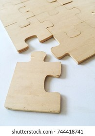 The wooden puzzles were almost complete. The background is white.