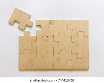 The wooden puzzles were almost complete.The background is white.