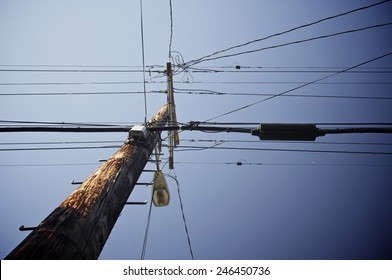 Wooden pylon with blue sky
