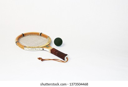 Wooden racquetball racket and ball